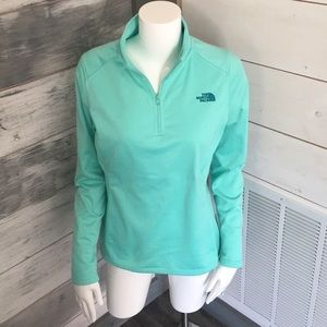 The North Face pullover jacket in mint color.
